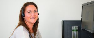 lady with a headset on making calls
